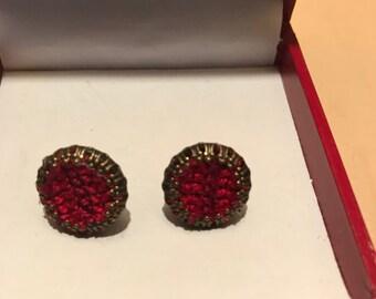 Cross stitch earrings.