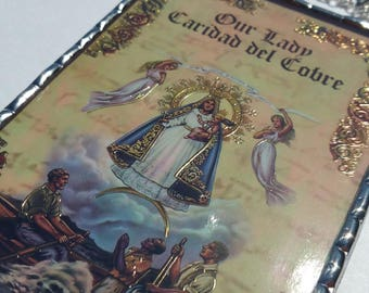 Our Lady of Caridad Del Cobre, Our Lady of Charity plaque with crystal cubes, lapis lazuli and freshwater pearls in iridescent water glass