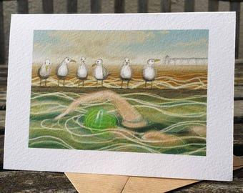 greetings card: seagulls and a swimmer, Clevedon Marine Lake, 'A Swim Before Barney'. Triathlon swimmer