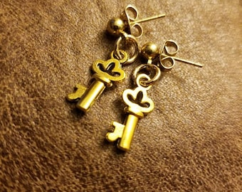 Gold key earrings on posts