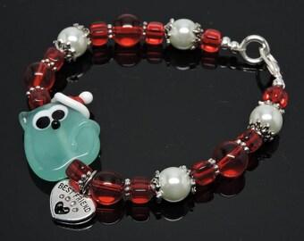 SANTA KITTY:  Artist Lampwork Glass Bracelet Light Blue Green