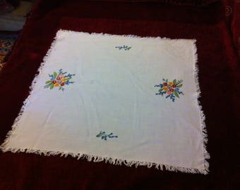 Vintage handmade embroidery on cotton linen doily