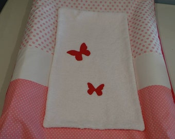Cover for changing mat in shades of pink and white on the theme of butterflies