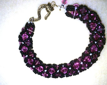 Swarovski Crystals Netted Bracelet, rose pink, with black seed beads and white accents.