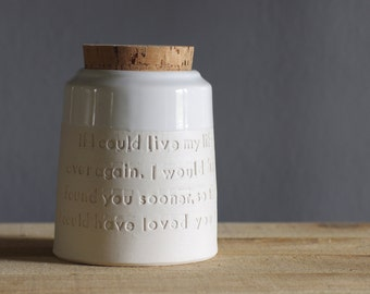 Custom urn with quote for ashes or cremains. Customize name, size and color. Modern pottery cremation urn. White on white shown