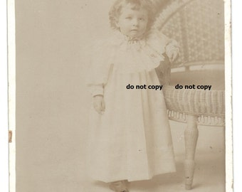 sweet toddler in fancy white gown,  cabinet card photo, antique photograph, vintage photography, wicker chair, possible post mortem photo