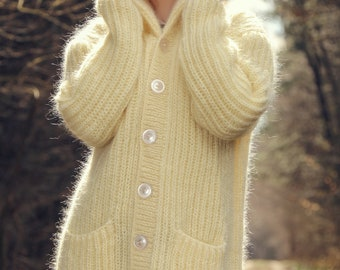Fuzzy ivory cardigan with pockets made to order by SUPERTANYA
