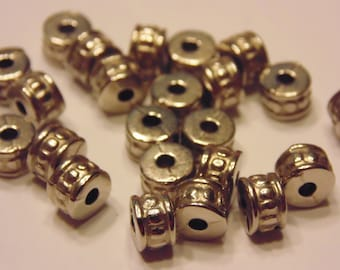 50 silver plated spacer beads, 4 x 6 mm (K11)