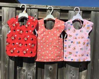 TODDLER REVERSIBLE BIBS in many toddler themes.
