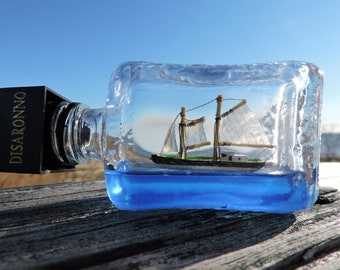 Fishing Schooner, Ship in a bottle, sailing on a deep blue sea