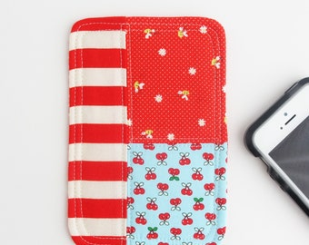 Phone Patchwork Coaster | Red and turquoise cotton fabric smartphone accessory for desk or home.