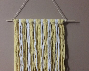 Handmade Yellow Super Soft yarn wall hanging.  Great in any room.
