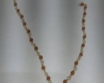 SGR109 one foot  2mm to 2.5 mm cornaline  gold plated  rosary chain /wire wrapped chain  .