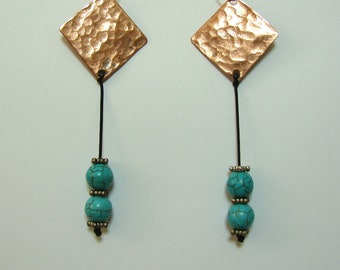 Handmade hammered copper earrings with blue beads