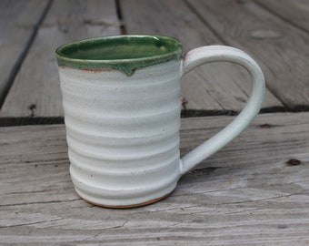 Wavy white and green wheel-thrown mug
