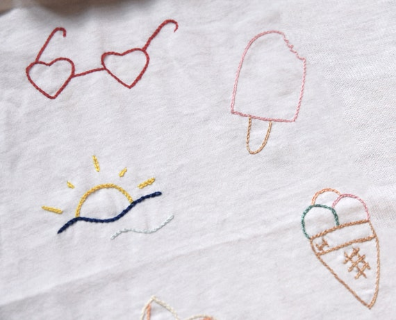 Sunglasses, popsicle, sunset, ice cream, flower, flag, anchor, summer embroidered tee