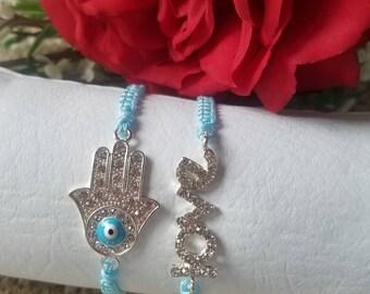Hand and love bracelets