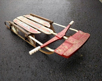 Vintage Silver Streak sled with rockets decorations.
