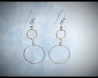 Gold and Silver Hoop type earrings