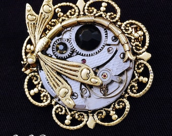 Eye of Horus - Surrealistic Steampunk Ancient Egyptian Symbol Of Protection - UNISEX Convertible Necklace Pin - Watch Movement And Dragonfly