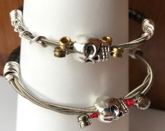 Guitar string bangle bracelet, half wrapped with leather and finished with a  silver skull bead, recycled guitar string