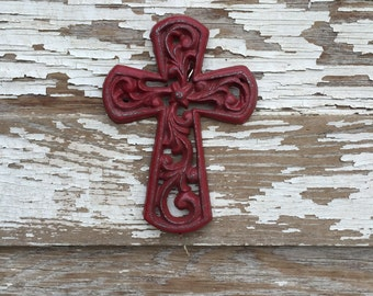 Cast iron cross painted red