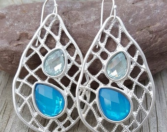 Silver plated oval earrings with a pop of Turquoise beads!!