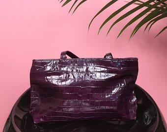 Purple patent alligator bag