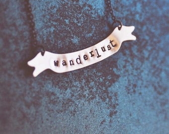 wanderlust banner necklace.
