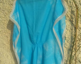 boat neckline hand-painted blue poncho