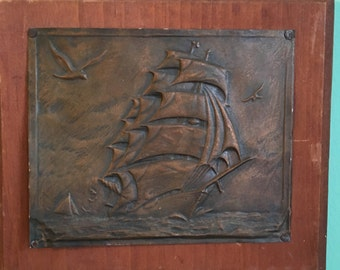 Embossed Copper Ship on Wood