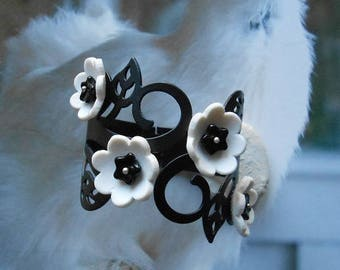 Cuff Bracelet stiff, romantic, articulated, adjustable, black and white, black metal scrollwork, flowers white porcelain and black glass
