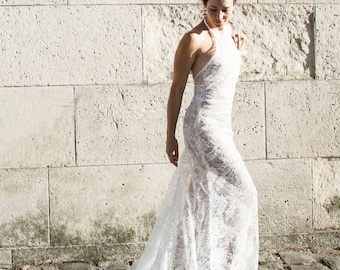 Backless Lace Wedding Dress | Sheer Halter Neckline with Low Back leading into a Fitted Skirt and Cathedral Train