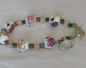 Pink rose with green accents bracelet