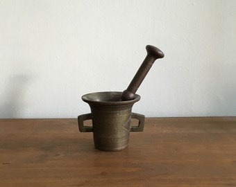 heavy antique bronze mortar and pestle. brass mortar and pestle. rustic primative spice grinder. antique apothecary.