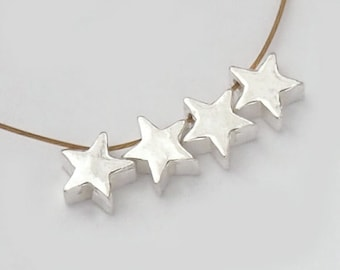 4 of 925 Sterling Silver Little Star Beads 5mm. :th1871