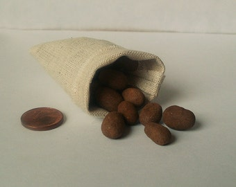 Sack with potatoes, dollhouse miniature 1/12