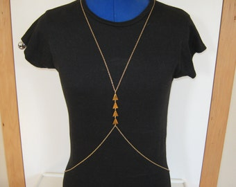 gold body chain with gold triangle detail can also be worn as a necklace
