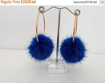 Rapid sale Bright blue fur pompom hoops .   Stainless steel earrings with mink pompom.