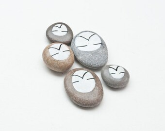 Daydreaming set of five hand painted natural stones