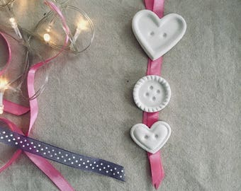 Perfumed plaster buttons