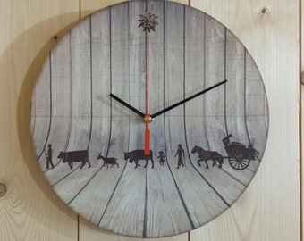Wooden original decor clock with cut edelweiss poya and wood.