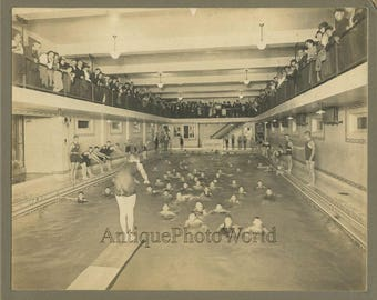 Boys swimmers swimming diving competition in pool w spectators antique photo