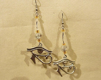 "Egyptian Eye of Horus silver tone earrings. 3"" or 7cm long x 1.25"" or 3cm"