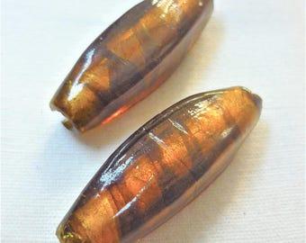 2 glass beads transparent orange 37mm