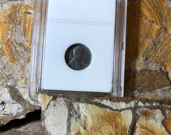 1943 steel wheat penny encapsulated in circulated condition