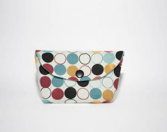 Small pouch or wallet in cotton with multicolored dots closing by pressure