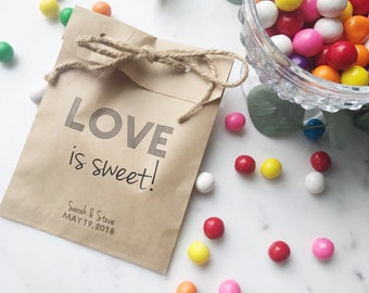 Love is sweet! Personalized paper favor bags to hold candy from the candy bar! Great for wedding favors, bridal shower, or engagement party!
