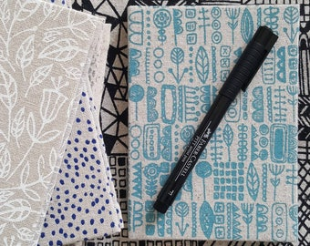 Pocket sized hardback notebook in screen printed fabric by Lucie Summers, Totem design in Seafoam