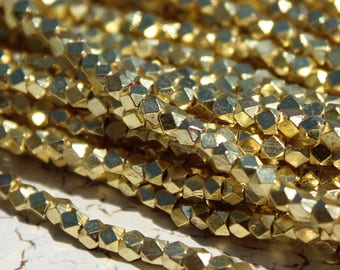 Gold Plated Metal Beads, Polygons with Diamond Facets from India - M-008